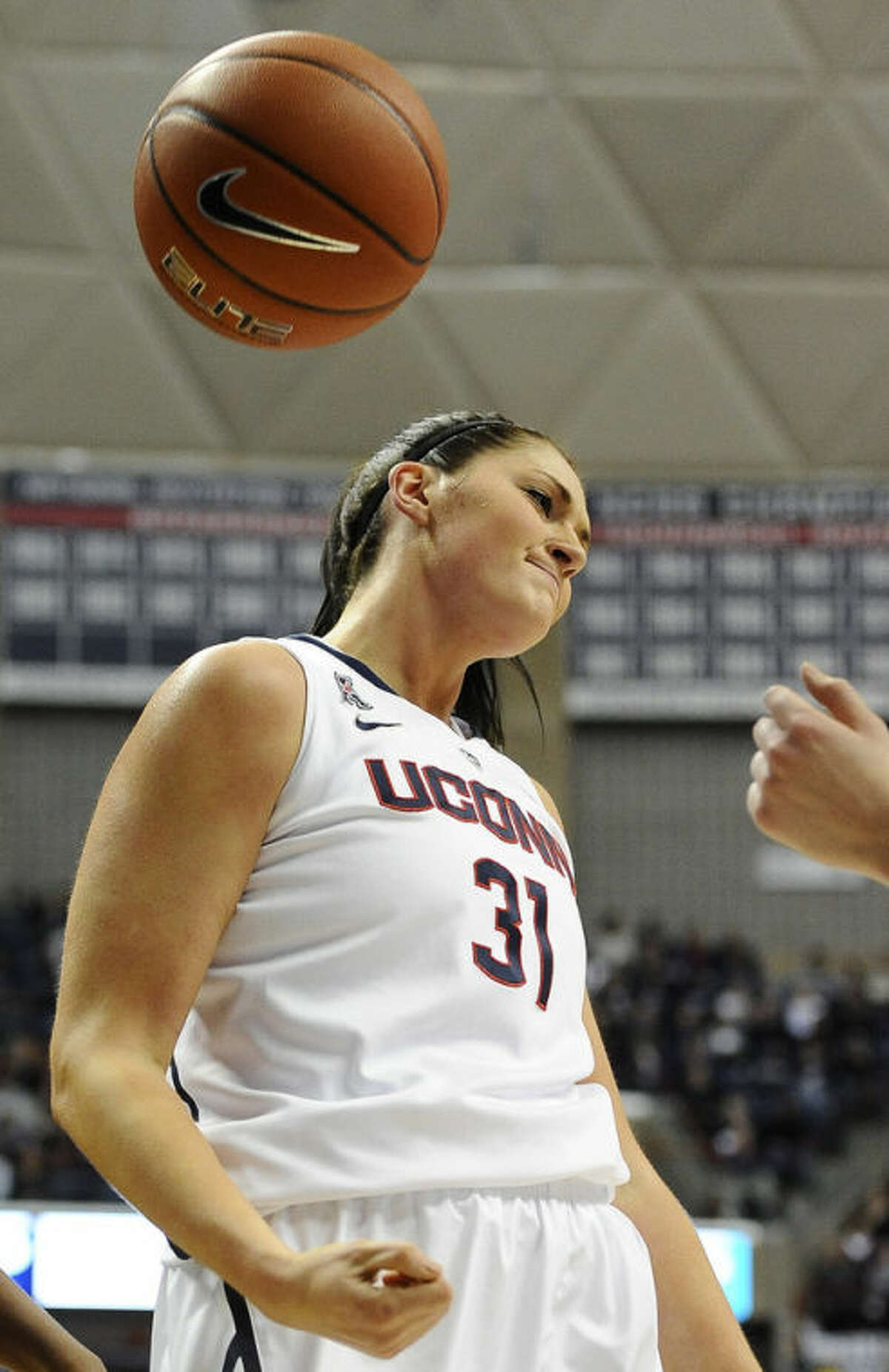 Connecticut's Stefanie Dolson reacts after being fouled during the first half of an NCAA college basketball game against Cincinnati, Sunday, Dec. 29, 2013, in Storrs, Conn. (AP Photo/Jessica Hill)