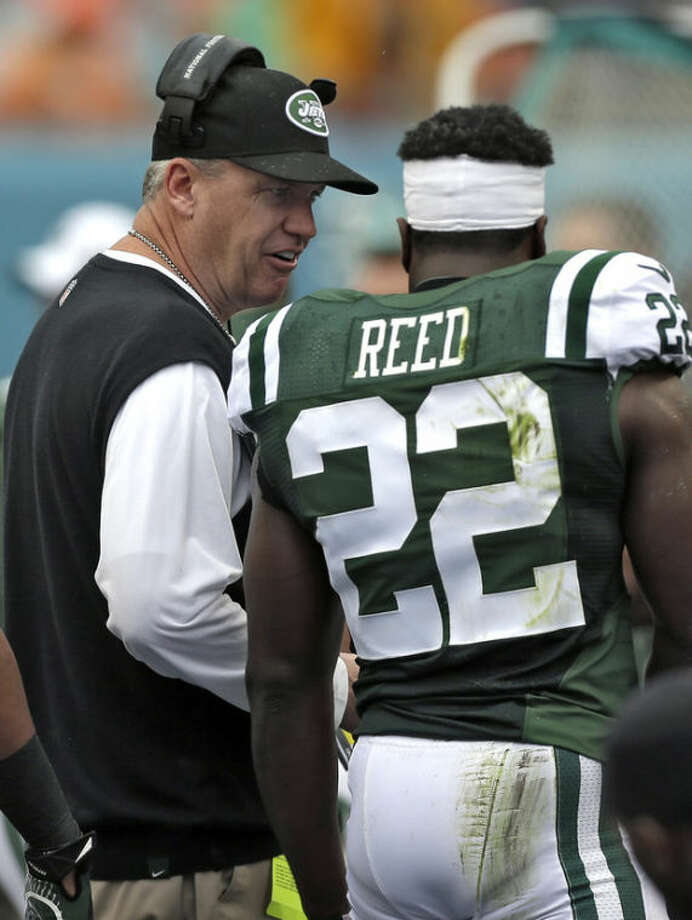 New York Jets head coach Rex Ryan, left, talks to safety Ed Reed during the second quarter of an NFL football game against the Miami Dolphins Sunday, Dec. 29, 2013, in Miami Gardens, Fla. (AP Photo/Alan Diaz)