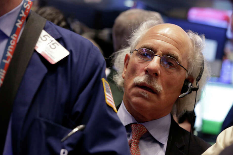 FILE - In this Wednesday, Dec. 18, 2013, file photo, trader Peter Tuchman works on the floor of the New York Stock Exchange. (AP Photo/Richard Drew, File) / AP
