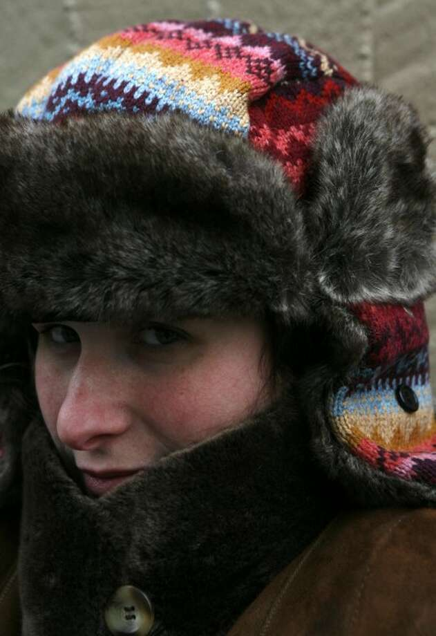 Associated Press staffer Samantha Critchell poses for a picture wearing a trapper hat in New York, Tuesday, Jan. 6. (AP Photo/Seth Wenig)