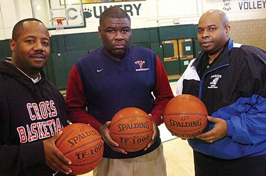 Anthony Hill, Scott Nails and Gary Peterson all graduated from Norwalk in 1987 and now are all coaching their own high school basketball teams. hour photo/matthew vinci