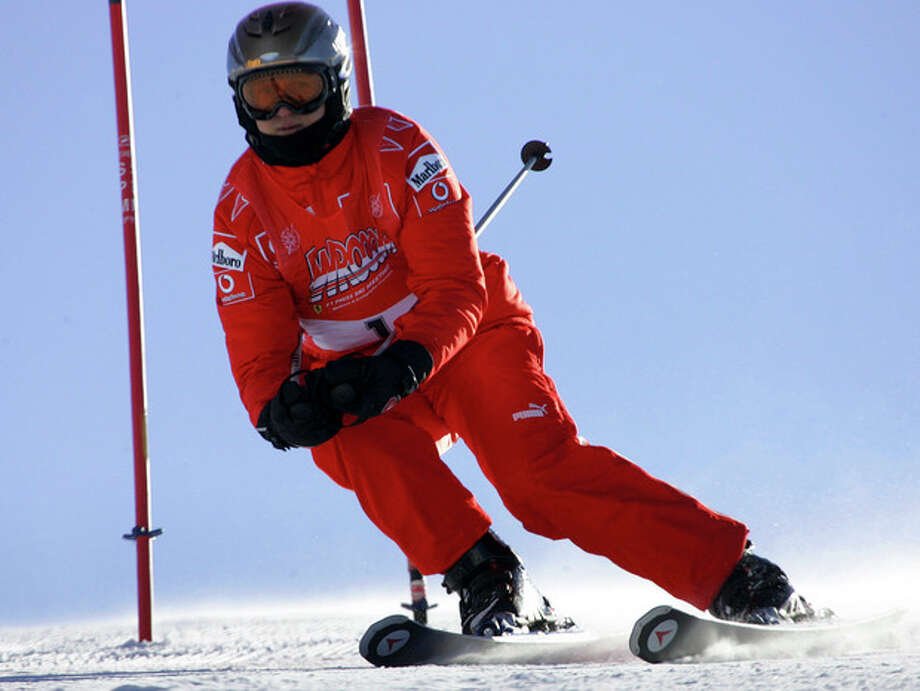 FILE - In this Friday, Jan. 13, 2006 file photo, Ferrari driver Michael Schumacher of Germany speeds down a course in Madonna di Campiglio, Italy. Schumacher is in this Italian Alps ski resort for the yearly meeting between Ferrari drivers and the press. French radio says retired Formula One champion Michael Schumacher has been injured in a skiing accident. RMC radio reported Sunday Dec. 29, 2013 that the seven-time champion had fallen while skiing off-piste at the French Alpine resort of Meribel. The radio quoted resort director Christophe Gernigon-Lecomte as saying that Schumacher was wearing a helmet when he fell and hit a rock. (AP Photo/Luca Bruno, File) / AP