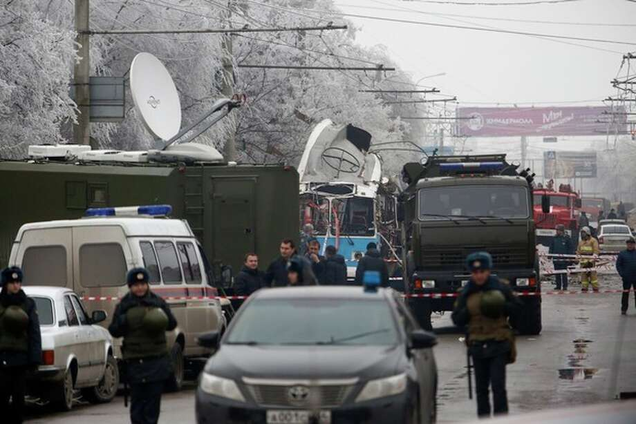 Military vehicles surround a wreckage of a trolleybus, in Volgograd, Russia, Monday, Dec. 30, 2013. A bomb blast tore through a trolleybus in the city of Volgograd on Monday morning, killing at least 10 people a day after a suicide bombing that killed at least 17 at the city's main railway station. Volgograd is about 650 kilometers (400 miles) northeast of Sochi, where the Olympics are to be held. (AP Photo/Denis Tyrin) / AP