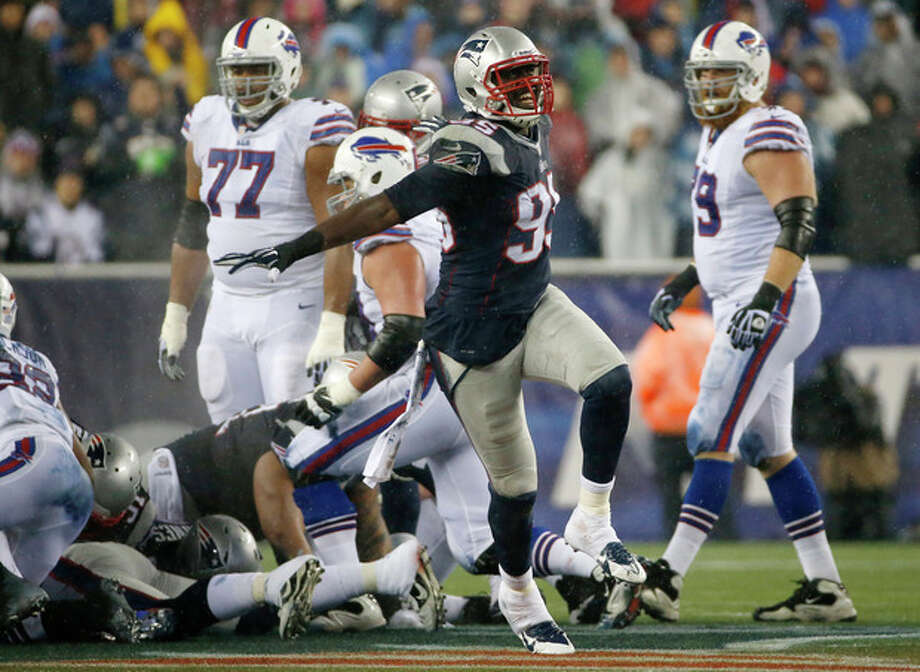 New England Patriots defensive end Chandler Jones (95) celebrates after the Patriots stopped the Buffalo Bills on fourth down during a drive in the second quarter of an NFL football game, Sunday, Dec. 29, 2013, in Foxborough, Mass. (AP Photo/Elise Amendola) / AP