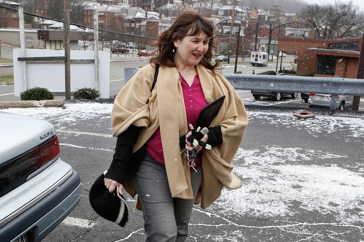 Shelagh Collins walks from her car to a job search appointment on Monday, Dec. 30, 2013, in Forest Hills, Pa., an eastern suburb of Pittsburgh. Collins gets by on occasional secretarial temp work and unemployment compensation checks, but she can?'t afford specialized treatment for her various health conditions that limit her ability to do certain jobs. On Thursday, Jan. 2, 2014, about half the states will expand Medicaid eligibility to more of the working poor under the federal health care law. But Pennsylvania and 24 other states aren?'t expanding Medicaid, and the Kaiser Family Foundation estimates nearly 5 million Americans will fall into a coverage gap because of it. (AP Photo/Keith Srakocic)
