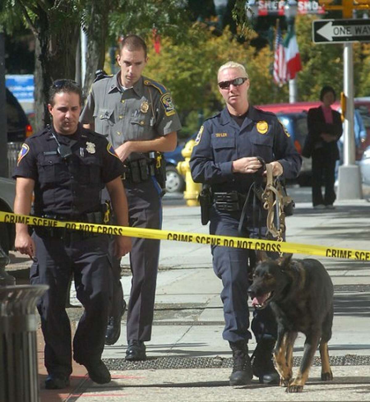 Photo/Alex von Kleydorff. Stamford Police and the State police along with State Police K9 unit arrive to investigate a bank robbery at Wachovia Bank on Main Street Stamford Tuesday morning