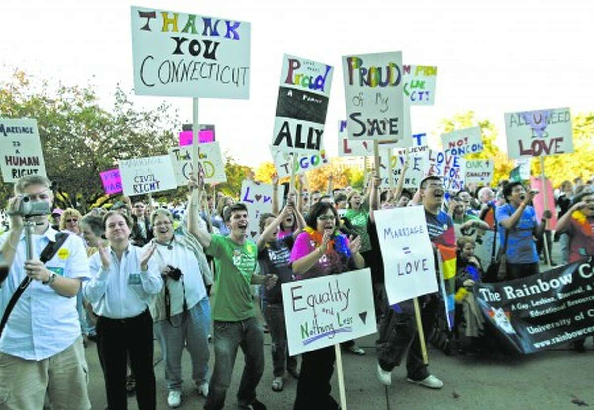 The audience cheers at a rally at the State Capitol in Hartford, Conn., Friday, Oct. 10, 2008 held to celebrate a ruling by the Connecticut Supreme Court to allow same-sex weddings. (AP Photo/Bob Child)