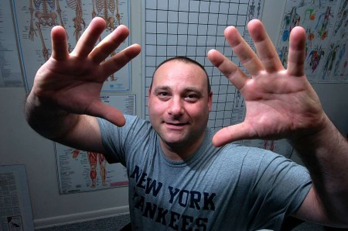 Photo/Alex von Kleydorff/ Massage Therapist for the New York Yankees, Lou Potter shows his tools of the trade.