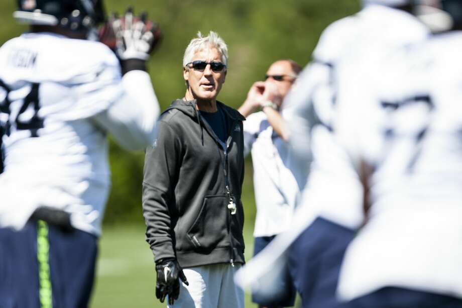 Seahawks head coach Pete Carroll talks with defensive end DeAngelo Tyson during minicamp at Virginia Mason Athletic Center in Renton, Wa., Thursday, June 16, 2016. (Lacey Young, seattlepi.com) Photo: LACEY YOUNG/SEATTLEPI.COM