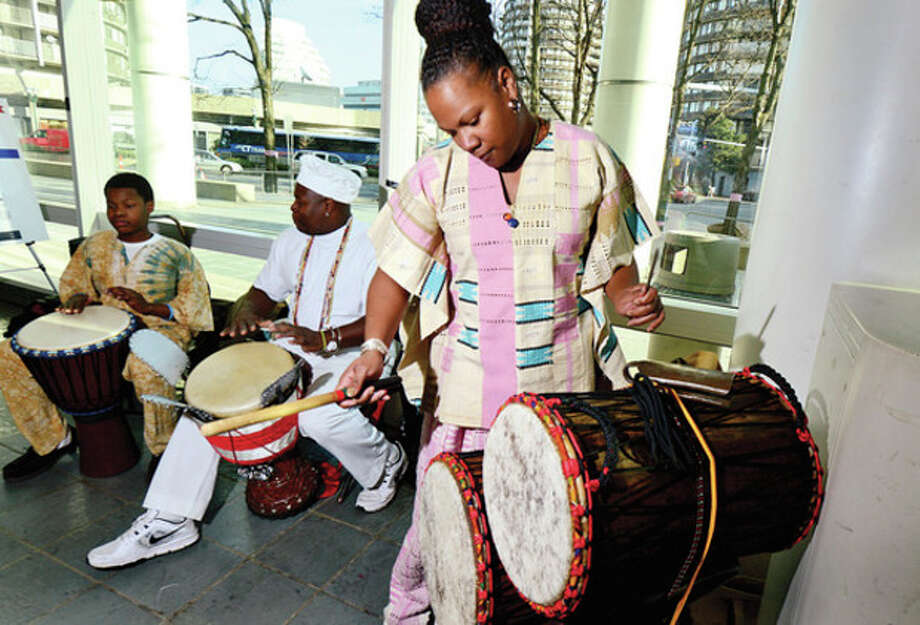 The Afican drum troupe Infinite Roots performs during Stamford's 19th annual Mayor's Kwanzaa Celebration at the Stamford Government Center Friday. / (C)2013, The Hour Newspapers, all rights reserved