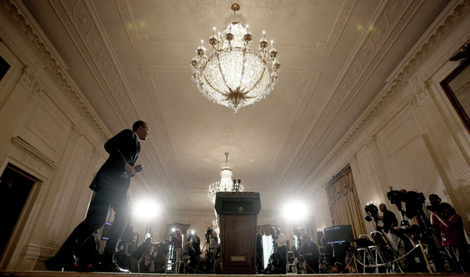 "FILE - This May 15, 2013 file photo shows President Barack Obama walking toward the podium to make a statement on the Internal Revenue Service's targeting of conservative groups for extra tax scrutiny, in the East Room of the White House in Washington. It was a moment for Barack Obama to savor. His second inaugural address over, Obama paused as he strode from the podium last January, turning back for one last glance across the expanse of the National Mall, where a supportive throng stood in the winter chill to witness the launch of his new term. ""I want to take a look, one more time,"" Obama said quietly. ""I'm not going to see this again.""There was so much Obama could not _ or did not _ see then, as he opened his second term with a confident call to arms and an expansive liberal agenda. (AP Photo/Pablo Martinez Monsivais, File) / AP"