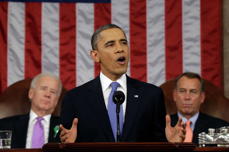 "FILE - This Feb. 12, 2013 file photo shows President Barack Obama, flanked by Vice President Joe Biden and House Speaker John Boehner of Ohio, giving his State of the Union address during a joint session of Congress on Capitol Hill in Washington. It was a moment for Barack Obama to savor. His second inaugural address over, Obama paused as he strode from the podium last January, turning back for one last glance across the expanse of the National Mall, where a supportive throng stood in the winter chill to witness the launch of his new term. ""I want to take a look, one more time,"" Obama said quietly. ""I'm not going to see this again.""There was so much Obama could not _ or did not _ see then, as he opened his second term with a confident call to arms and an expansive liberal agenda. (AP Photo/Charles Dharapak, File-Pool) / AP Pool"