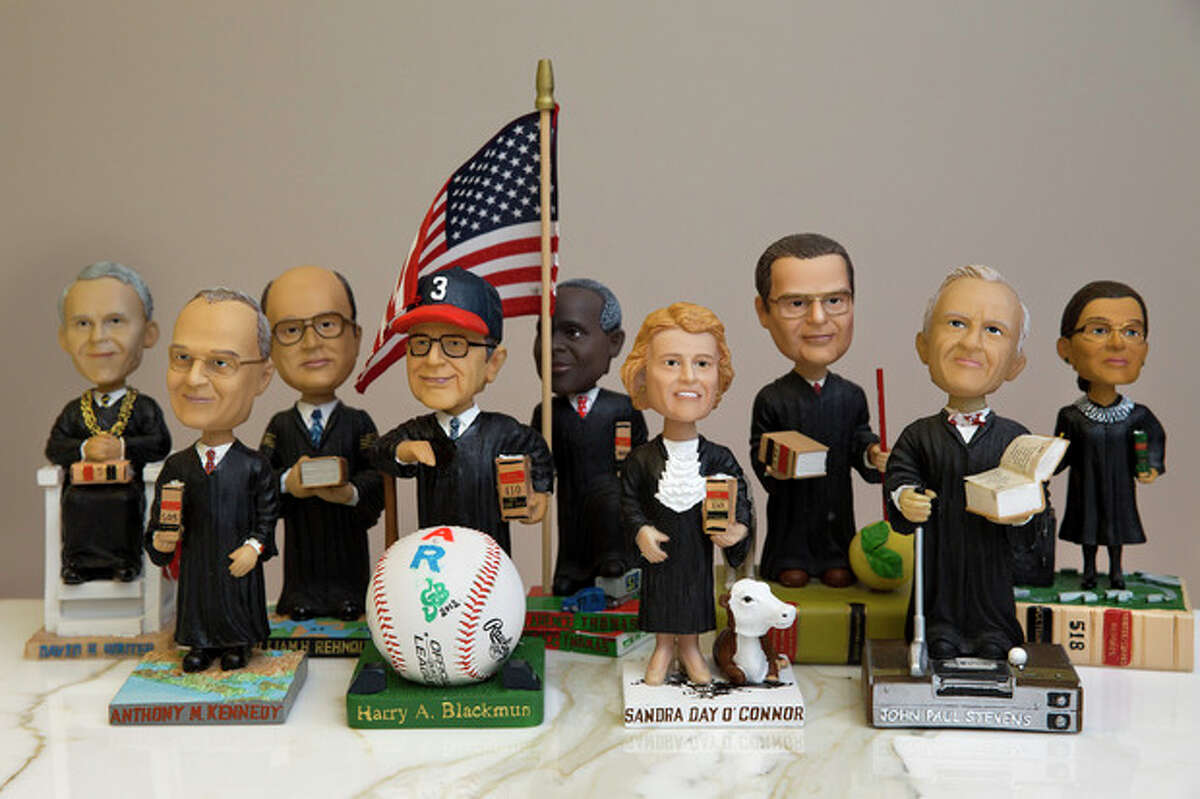 This photo taken Nov. 20, 2013 shows bobblehead dolls representing Supreme Court Justices, in Washington. They are some of the rarest bobblehead dolls ever produced. They?'re released erratically. They?'re given away for free, not sold. And if you get a certificate to claim one, you have to redeem it at a Washington, DC, law office. The limited edition bobbleheads of U.S. Supreme Court justices are the work of law professor Ross Davies, who has been creating them for the past ten years. When finished, they arrive unannounced on the real justices?' desks, secreted there by unnamed confederates. And fans will go to some lengths to get one. (AP Photo/Jacquelyn Martin)