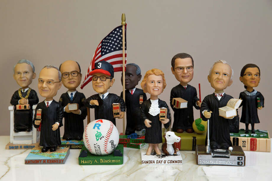 This photo taken Nov. 20, 2013 shows bobblehead dolls representing Supreme Court Justices, in Washington. They are some of the rarest bobblehead dolls ever produced. They're released erratically. They're given away for free, not sold. And if you get a certificate to claim one, you have to redeem it at a Washington, DC, law office. The limited edition bobbleheads of U.S. Supreme Court justices are the work of law professor Ross Davies, who has been creating them for the past ten years. When finished, they arrive unannounced on the real justices' desks, secreted there by unnamed confederates. And fans will go to some lengths to get one. (AP Photo/Jacquelyn Martin) / AP