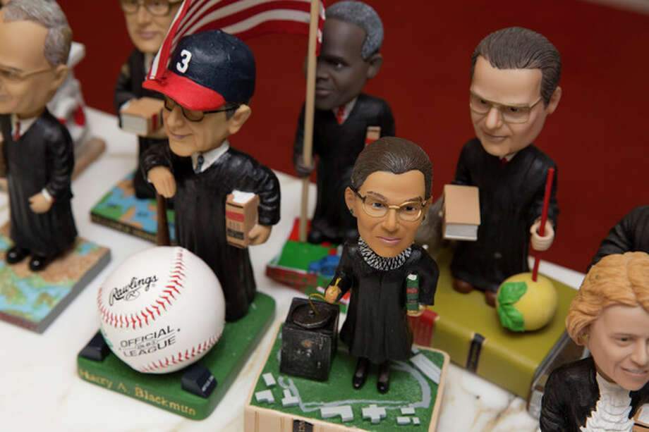 This photo taken Nov. 20, 2103 shows bobblehead dolls representing Supreme Court Justices, including Ruth Ginsburg, center, in Washington. They are some of the rarest bobblehead dolls ever produced. They're released erratically. They're given away for free, not sold. And if you get a certificate to claim one, you have to redeem it at a Washington, DC, law office. The limited edition bobbleheads of U.S. Supreme Court justices are the work of law professor Ross Davies, who has been creating them for the past ten years. When finished, they arrive unannounced on the real justices' desks, secreted there by unnamed confederates. And fans will go to some lengths to get one. (AP Photo/Jacquelyn Martin) / AP