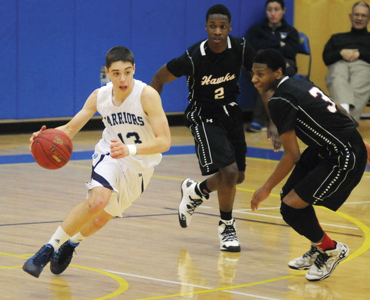 Hour photo/John Nash Wilton's Matt Shifrin, left, pushes the ball up the court past University's William Hardie, center, and Michael Gilliam during Monday's championship game of the Newtown Hoops for Hope Tournament. Shifrin had 25 points to lead Wilton to the win.