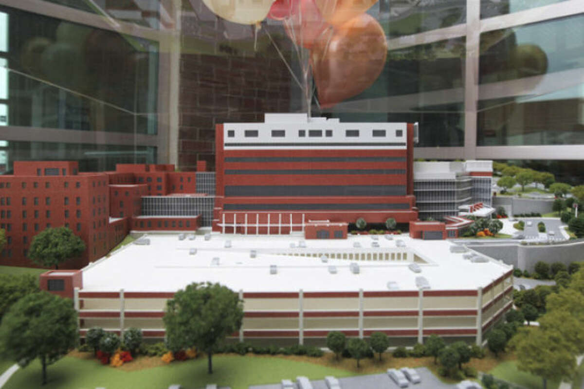 Hour Photo / Chris Palermo. A model of Norwalk Hospital on display, with the soon to be completed Amulatory Pavilion (far right), at the beam signing reception for all donors who contributed to the Legacy of Caring capital campaign at Norwalk Hospital Tuesday afternoon. Donors were invited to leave their mark on Norwalk Hospital's history by signing the large steel beam that be used to support the new pavilion entrance.