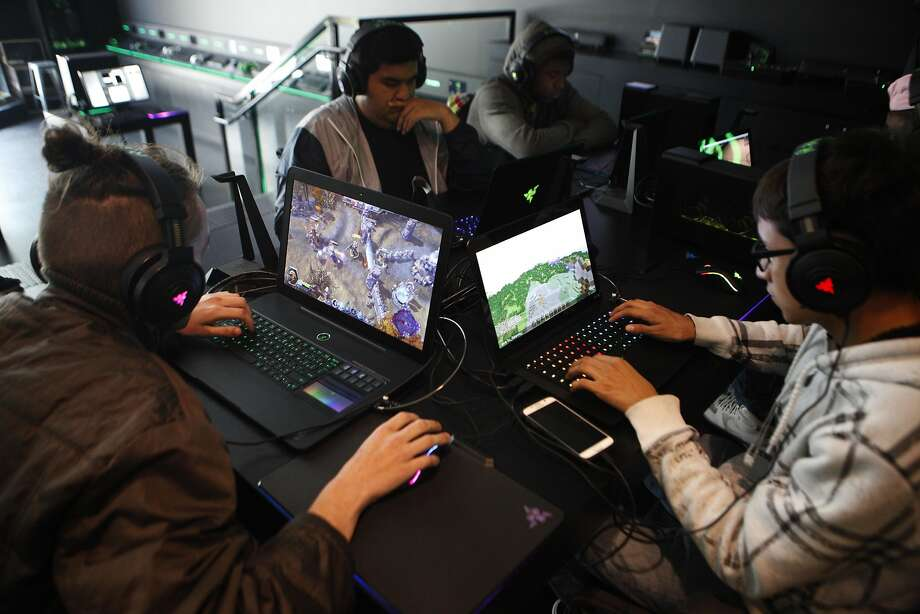 Storegoers play computer games like League of Legends and Minecraft on computer provided by Razer at the Razer store on Wednesday, June 15, 2016 in San Francisco, California. Photo: Michael Noble Jr., The Chronicle