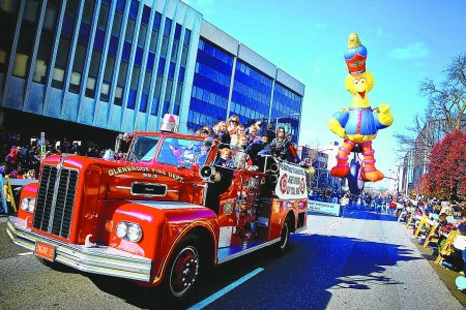 Engine 33 of the Glenbrook Fire Dept. of Stamford leads the Big Bird float up Summer Street in Stamford during the UBS Parade Spectacular Sunday afternoon. Hour photo / DAVID ESPOSITO