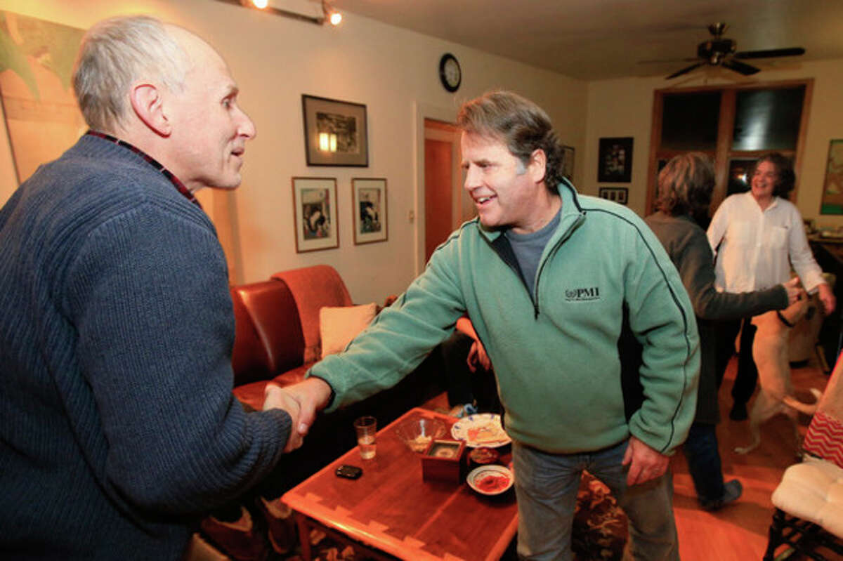 Hour photo / Chris Palermo Peter Willcox is greeted by his cousin David Lewis on Tuesday evening shortly after arriving in Norwalk at his parent's house. Willcox was imprisoned in Russia after getting captured on a Greenpeace mission.
