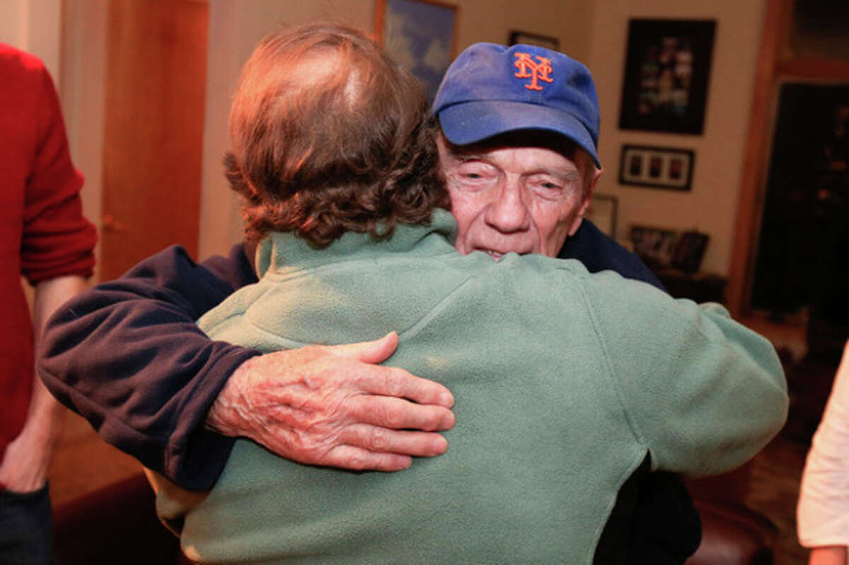 Hour photo / Chris Palermo Roger Willcox hugs his son Peter in their home in Norwalk Tuesday evening. Peter was recently released from a Russian prison.