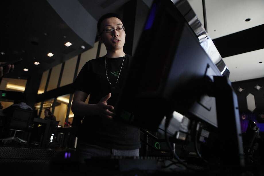 Razer store manager Jameson Tai demonstrates the functions of software at the Razer store on Wednesday, June 15, 2016 in San Francisco, California. Photo: Michael Noble Jr., The Chronicle
