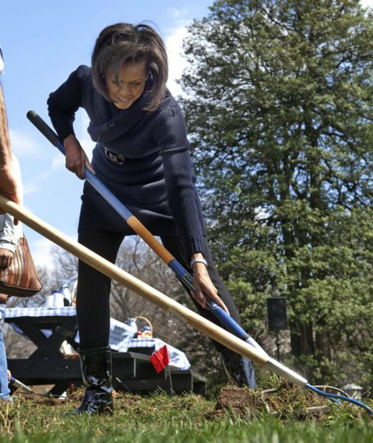 FILE- This march 20, 2009 file photo shows first lady Michelle Obama taking part in the groundbreaking of the White House Kitchen Garden on the South Lawn of the White House in Washington with students from Washington''s Bancroft Elementary School. (AP Photo/Ron Edmonds,File)