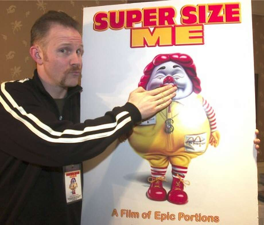 "FILE-This March 3, 2004 file photo shows Morgan Spurlock,director, producer and star of the documentary film ""Super Size Me"", clowns with a movie poster at the U S Comedy Arts Festival. (AP Photo\\E Pablo Kosmicki,File)"