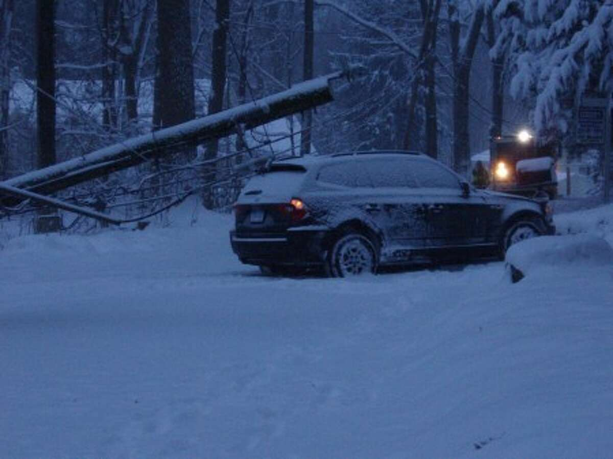 STORM COVERAGE: Snow covered roads cause Westport accident; Charcoal Hill Road closed for a short time