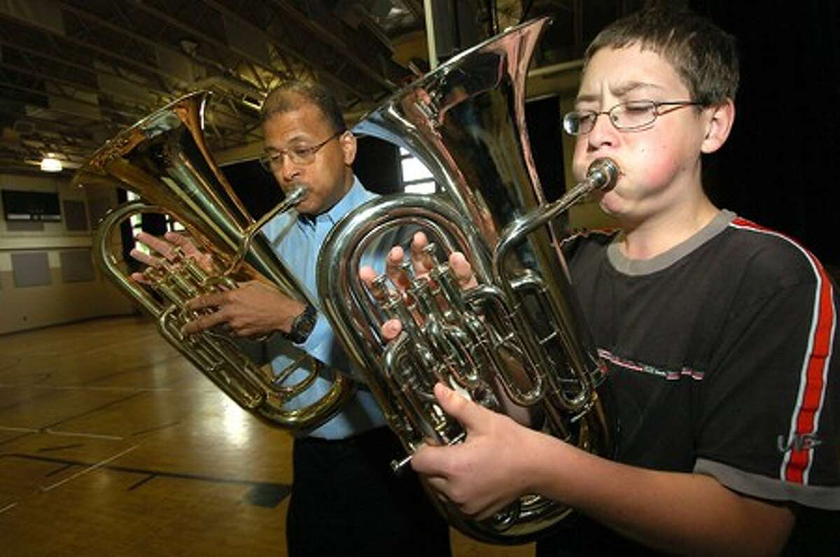 Photo/Alex von Kleydorff. Jim Marbury with The Norwalk Symphony Orchestra joins 8th grader Alex Garrison on the Baritone Horn during an instructional program at Side by Side School.