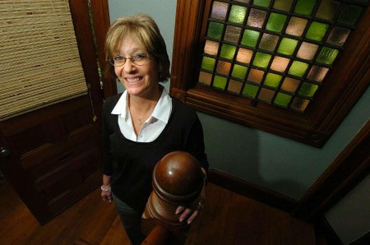 Photo/Alex von Kleydorff. Angela Lorenti, cancer survivor, in her Stamford home.