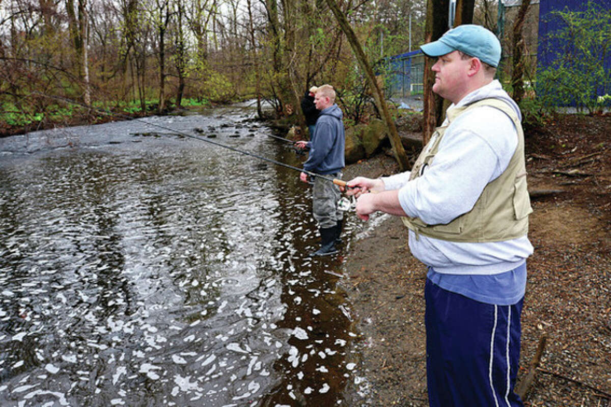 Paul Paris of Satmford fishes for trout on the Norwalk River in Wilton during opening day of 2013. Hour photo / Erik Trautmann