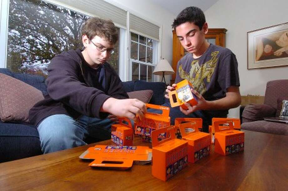 Photo/Alex von Kleydorff. l-r 17yr old Daniel Berman and brother 14yr old Jon, work on their UNICEF project.