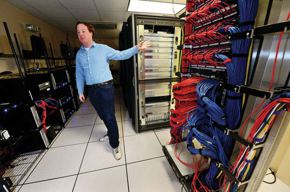 Datto CEO and Founder Austin McChord in his quickly expanding business's server room in Norwalk. Hour photo / Erik Trautmann