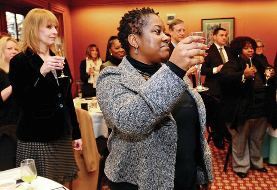Hour photo / Erik Trautmann Lucy Freeman of Malta House raisees her glass during a toast at the Greater Norwalk Chamber of Commerce Norwalk Leadership Institute (NLI) Graduation Breakfast at Dolce Norwalk Wednesday morning. / (C)2013, The Hour Newspapers, all rights reserved