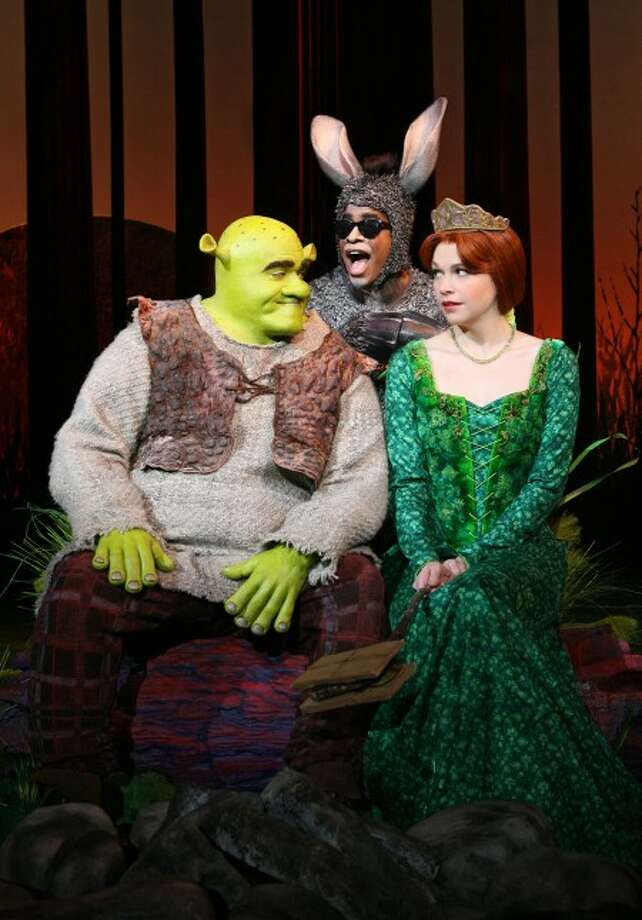 """Brian d''Arcy James as Shrek, left, with Daniel Breaker as Donkey and Sutton Foster as Princess Fiona in """"Shrek the Musical,"""" at the Broadway Theatre. (AP Photo/Boneau/Bryan-Brown, Joan Marcus)"""