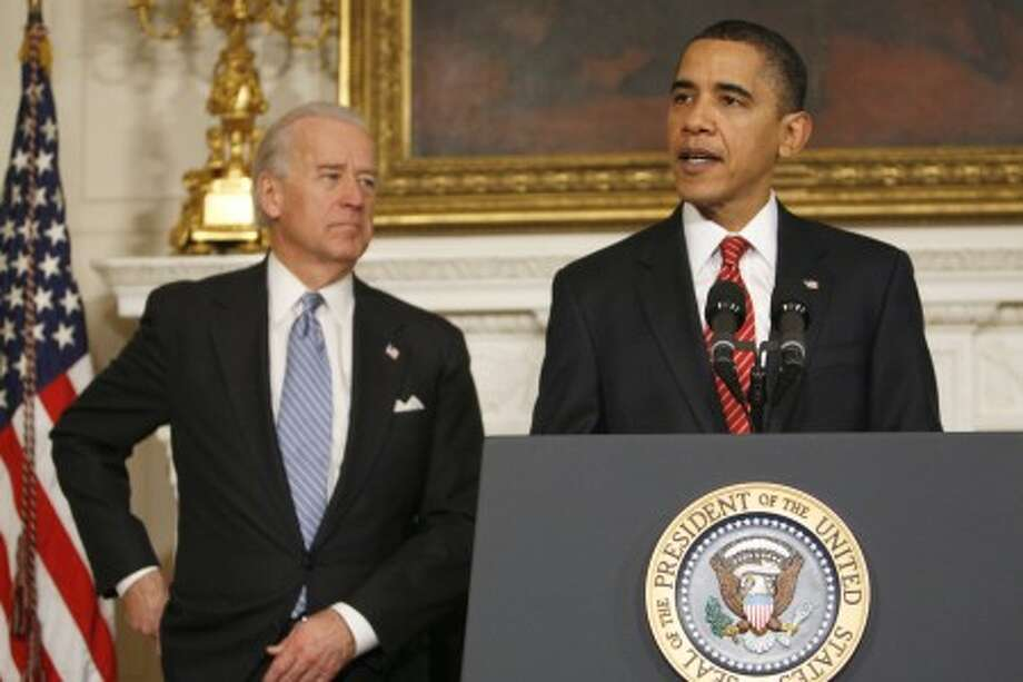 President Barack Obama, accompanied by Vice President Joe Biden, speaks in the State Dining Room of the White House in Washington, Thursday, Dec. 24, 2009, after the Senate passed the health care reform bill. (AP Photo/Evan Vucci) (Evan Vucci - AP)