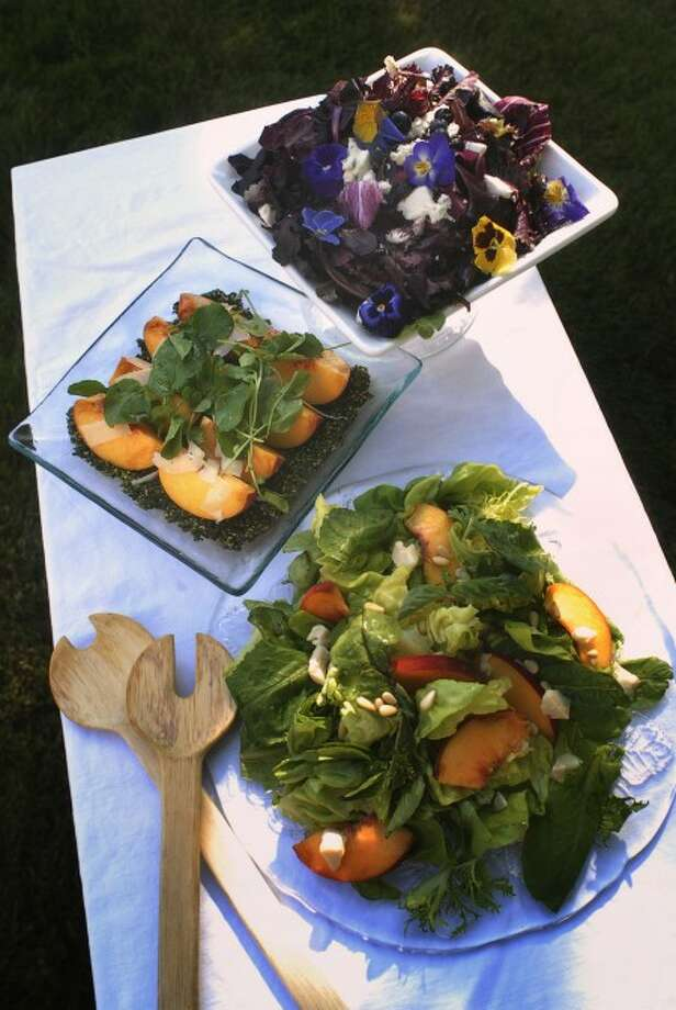 From top, baby blue salad with red leaf and gem lettuces, Pt. Reyes blue cheese, fresh blueberries, pansies and a blueberry chutney vinaigrette; peaches, parmesan and arugula salad on a basil puree; and mixed green salad with peaches, basil and chevre are perfect summertime salads. (MCT)