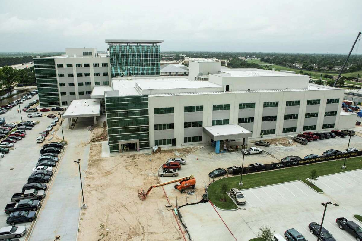Construction crews work on building the new Memorial Hermann Cypress Acute Care Hospital on Thursday, May 26, 2016, in Houston.