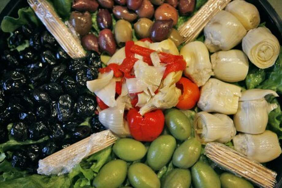 A plate of fresh olives and artichoke hearts is served during a raw vegan potluck dinner in Dallas, Texas, March 8. Proponents of the raw food lifestyle believe the diet helps many health issues and leads to increased energy and clarity of thought. (G.J. McCarthy/Dallas Morning News/MCT)