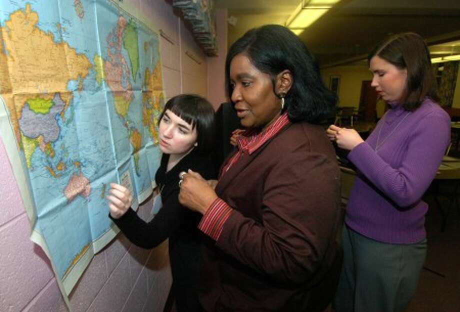 Photo/Alex von Kleydorff. l-r Madeline Martin-Seaver helps Barbara Bailey place a marker on the World map denoting people from countries the girls talked to while at the UN.