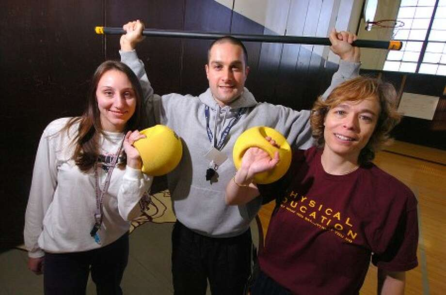 Photo/Alex von Kleydorff, L-R Dolan Middle School Phys.Ed. Instructor Amber Wilson, District Content Leader for Health and Phys. Ed. John Pelizzani and P.E. Instructor Andrea Wiesner work with Kettle balls and weighted bars.