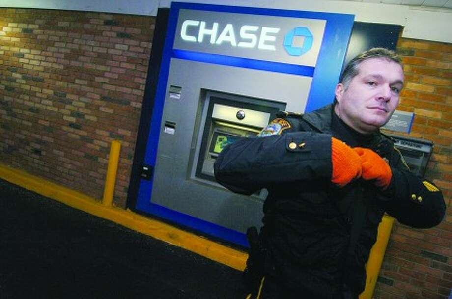 Wilton Police Capt. Michael Lombardo at the scene of an armed robbery at Chase bank on Danbury Rd in 2007. photo;Alex von Kleydorff file---03-02-07