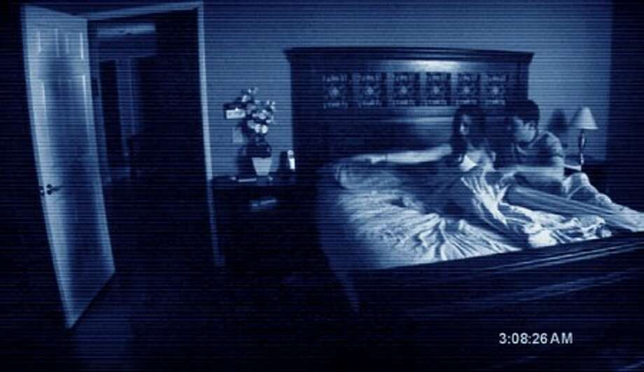 "In this film publicity image released by Paramount Pictures, a scene from the film, ""Paranormal Activity,"" is shown. (AP Photo/Paramount)"