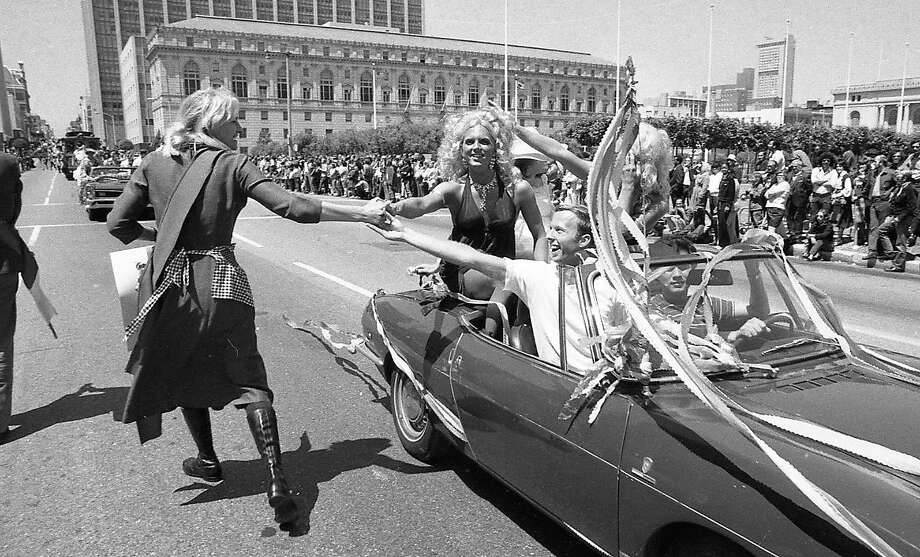 A convertible approaches the Civic Center during the first Gay Freedom Day Parade in San Francisco, on June 25, 1972. Photo: Greg Peterson, The Chronicle