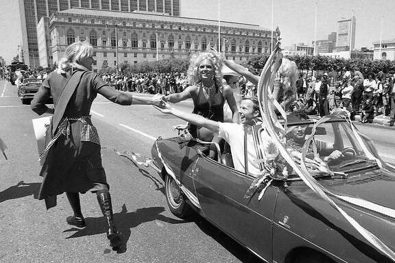 June 25, 1972: A convertible approaches the Civic Center during the first Gay Freedom Day Parade in San Francisco.