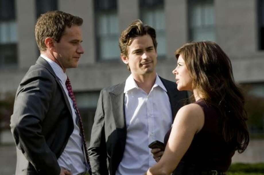"Tim Dekay, left, Matt Bomer and Tiffani Thiessen star in the USA Network television series, ""White Collar"". (David Giesbrecht/USA Network/MCT)"