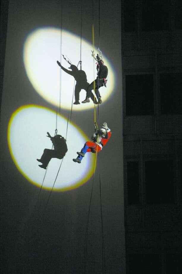 Santa and Rudolph descend the Landmark Building in Stamford Dec. 6. Photo courtesy of Happyhaha Photography Studio.