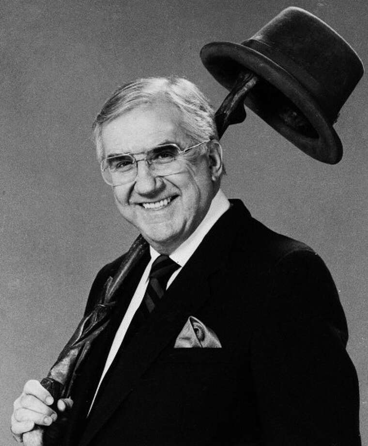 """This March, 1986 file photo shows Ed McMahon. McMahon, the loyal """"Tonight Show"""" sidekick who bolstered boss Johnny Carson with guffaws and a resounding """"H-e-e-e-e-e-ere''s Johnny!"""" for 30 years, died Tuesday morning, June 23, 2009 at a Los Angeles hospital. He was 86. (AP Photo)"""