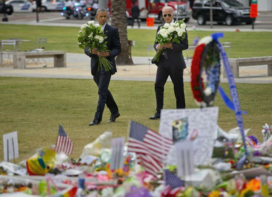 President Obama and Vice President Joe Biden visit a makeshift memorial to the victims of the Pulse nightclub shooting, in Orlando. Photo: Pablo Martinez Monsivais, Associated Press